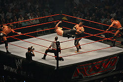 Jeff Hardy performing a low dropkick on Umaga in a tag-team match during 2007
