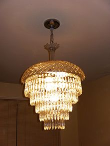 A Five Tier Wedding Cake Chandelier With Crystal Top