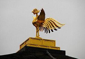 English: The garuda (phoenix-like bird in hind...