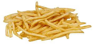 English: McDonald's french fries on a white st...