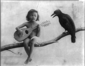 Little brown girl with mandolin, sitting ...