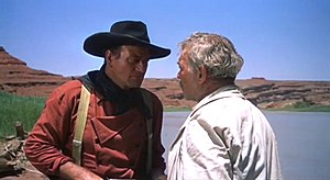 Ethan (John Wayne) angrily confronts the Rever...