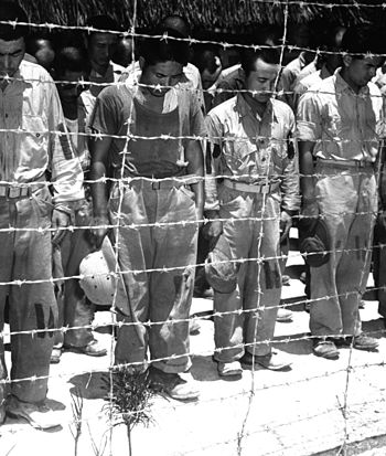 English: Japanese POW's at Guam, with bowed he...