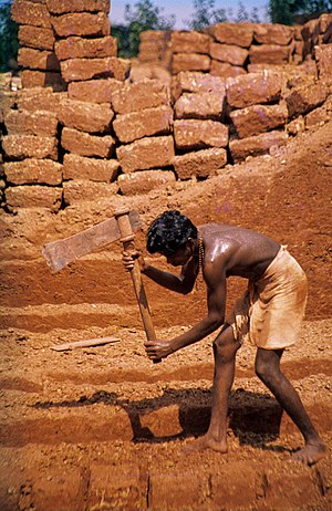 cutting of laterite brickstones. Angadipuram, ...