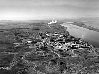 Nuclear reactors line the riverbank at the Hanford Site along the Columbia River in January 1960.