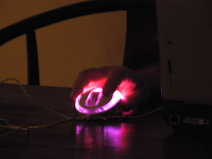 Pink computer mouse in the dark