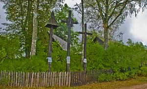Three wooden crosses in Zervynos, Lithuania, 1...