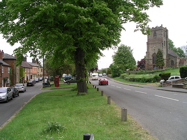 The church and road in Brinklow, Warwickshire,