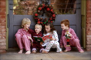 Four children reading the book How the Grinch ...