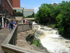 The Cuyahoga River descends through downtown C...
