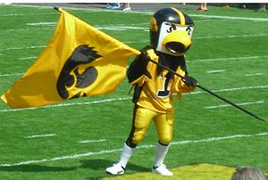 Photo taken by me of Herky the Hawkeye holding...