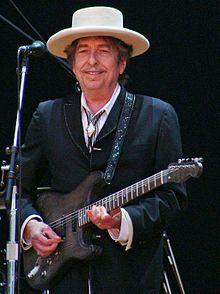 https://i1.wp.com/upload.wikimedia.org/wikipedia/commons/thumb/d/d5/Bob_Dylan_-_Azkena_Rock_Festival_2010_1.jpg/220px-Bob_Dylan_-_Azkena_Rock_Festival_2010_1.jpg