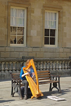 English: Harpist at Bath A young woman supplem...