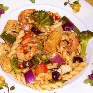 pasta salad with shrimp, chicken and vegetables