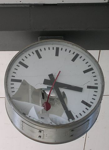 Broken station clock as the illustration or th...