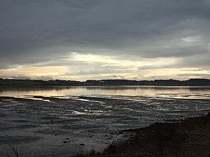 English: Evocative light at Dundrum Inner Bay....