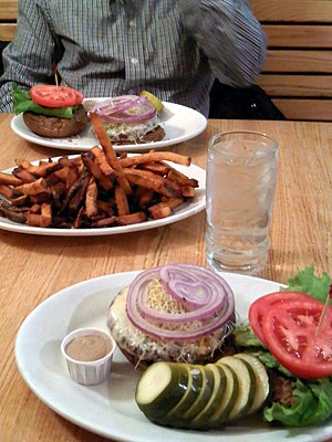 Veggie burger with fries.