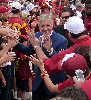 English: Head Coach Pete Carroll leads his Uni...
