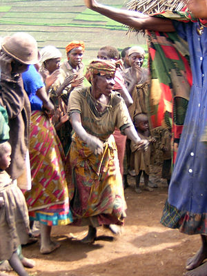 English: people dancing in a Batwa village in ...