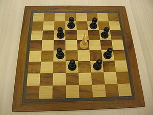 Chess board with a knight and pawns illustrati...