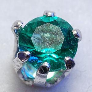 Emerald obsidianite set in an earring