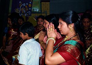 People praying during Durga puja. Original tit...