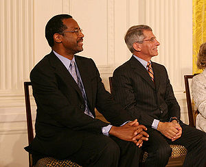 Dr. Benjamin Carson, left, seated with Dr. Ant...
