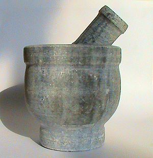 Mortar and pestle from China, side view. Photo...