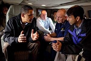 President Barack Obama talks with U.S. Coast G...