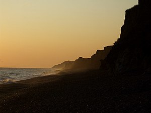 English: Orange glow at Weybourne Beach The ea...