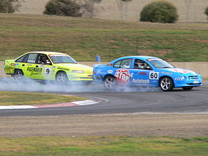 Race cars 60(Dane) and 9(Holmes) braking hard ...