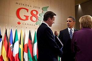 Barack Obama, President, talked with David Cam...