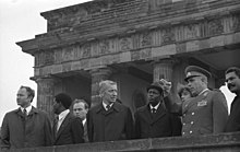 Dos Santos (fifth from the left) at the Brandenburg Gate during a 1981 state visit, with East German officials