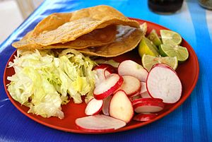 Plate with condiments for pozole to be added t...