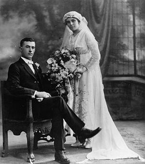 English: Formal studio wedding portrait, ca. 1910