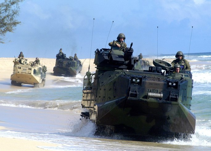 US Navy 050628-N-1397H-099 U.S. Marines assigned to the 3rd Amphibious Assault Battalion based out of Camp Pendleton, Calif., tread along the shoreline in Amphibious Assault Vehicles (AAVs)