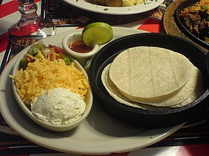 Condiments — sour cream, grated cheese, ...
