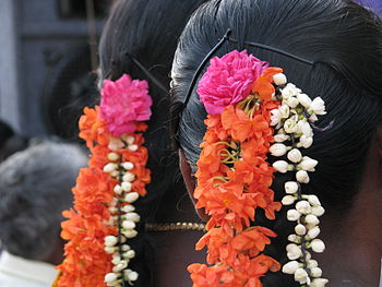 Women in Tamil nadu traditionally wear fresh f...