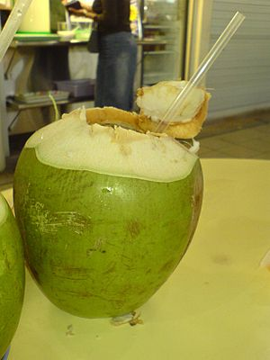 A coconut which has been stripped of its husk....