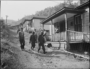 https://i1.wp.com/upload.wikimedia.org/wikipedia/commons/thumb/d/df/Miners_coming_home_from_morning_shift._Mullens_Smokeless_Coal_Company%2C_Mullens_Mine%2C_Harmco%2C_Wyoming_County%2C_West..._-_NARA_-_540933.jpg/313px-Miners_coming_home_from_morning_shift._Mullens_Smokeless_Coal_Company%2C_Mullens_Mine%2C_Harmco%2C_Wyoming_County%2C_West..._-_NARA_-_540933.jpg
