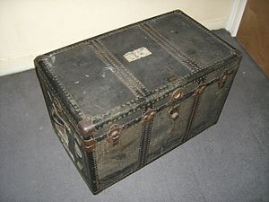 A large trunk with leather handles