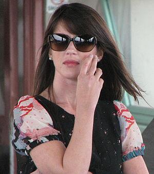 A woman wearing sunglasses, taken in a public ...