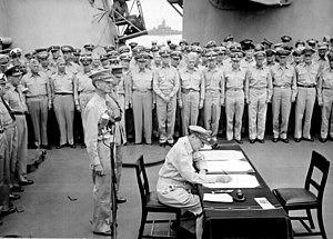 English: General Douglas MacArthur signs as Su...
