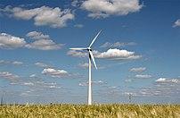 Modern wind energy plant in rural scenery.