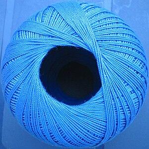 A ball of shiny blue crochet thread.
