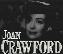 Face shot of Crawford; her hair is up and her expression somewhat sad.