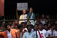 Aung San Suu Kyi addresses crowds at the NLD headquarters shortly after her release.