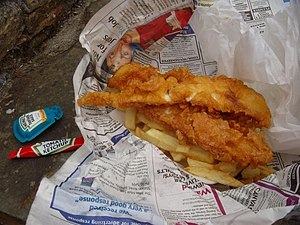 English: Fish and chips traditionally wrapped ...