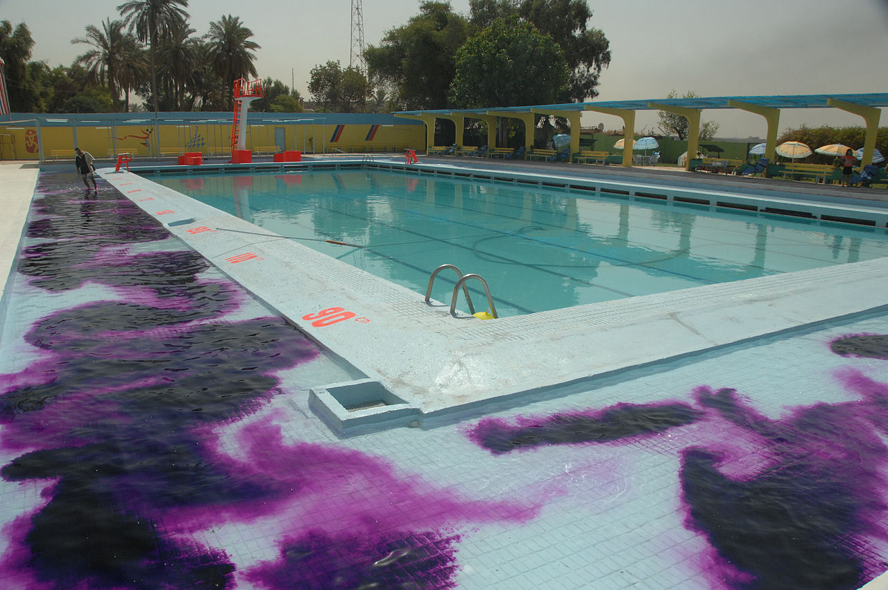 File Worker At The Al Amana Swimming Pool Put Purple Dye