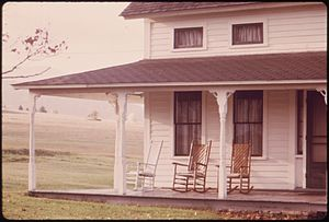 EMPTY ROCKING CHAIRS ON AN OLD FARMHOUSE PORCH...